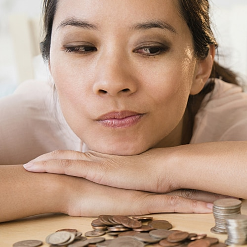 Woman smirking while looking at money