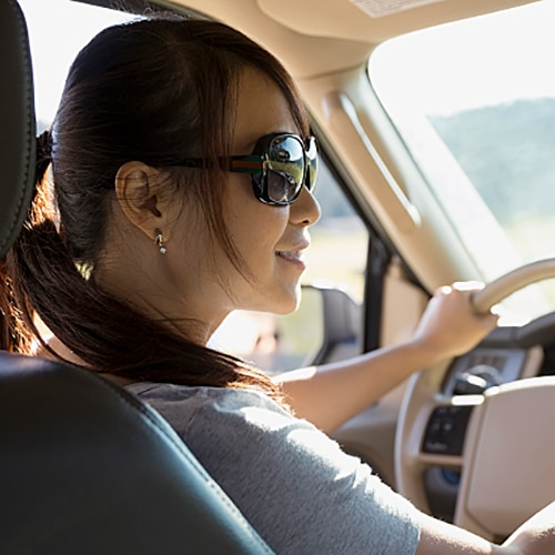 Woman with sunglasses on driving