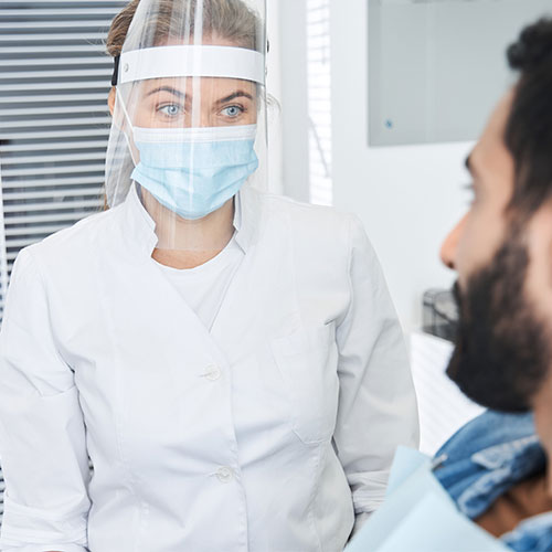portrait-view-female-dentist-wearing-protective
